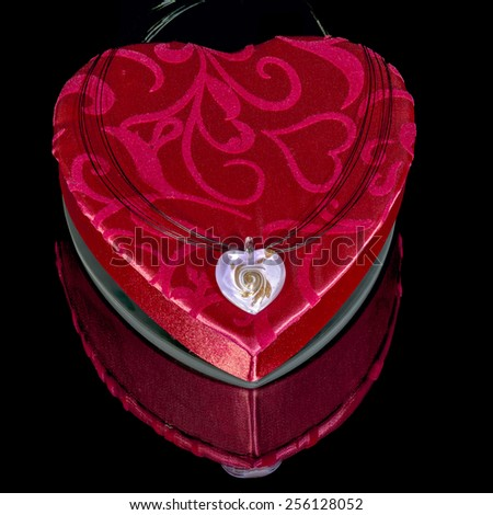 valentines heart shaped box with a pendant on it - stock photo