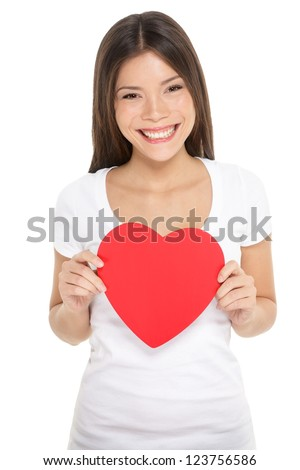Valentines woman holding heart smiling happy. Love concept with happy multiracial Asian / Caucasian female model isolated on white background. - stock photo