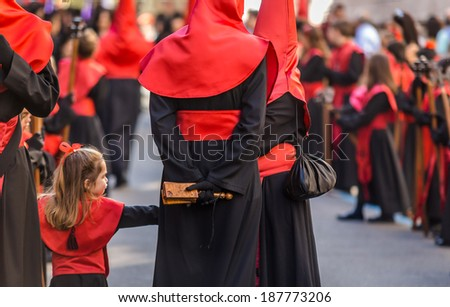 VALLADOLID, SPAIN � APRIL 17, 2014: Little girl participating in the religious processions during Holy Week on Good Thursday, on April 17, 2014 in Valladolid, Spain.