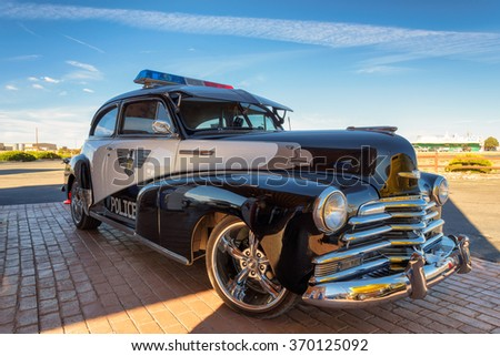 VALLE, ARIZONA - MARCH 26, 2015: Excellent old vintage  police car on a gas station on March 26, 2015 in Valle, Arizona. The Chevrolet Fleetmaster produced in the United States for 1946 model year.
