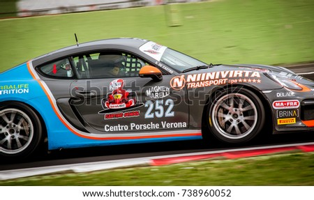 Vallelunga, Italy september 24 2017. Racing touring Porsche in action panning on turn on asphalt motorsport circuit closeup