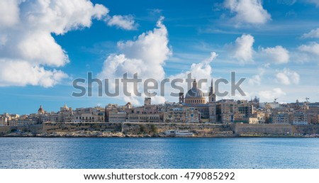 Valletta - December 2016, Malta: Valletta skyline with the St. Pauls Cathedral and Charmelite Church in sunny day with big clouds in the sky