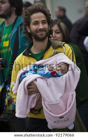 VALLETTA, MALTA - DEC 17 - A demonstrator holds his newborn child during a rally in favour of the decriminalisation and legalisation of cannabis and hemp, on 17 December 2011 - stock photo