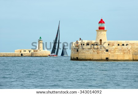 "VALLETTA, MALTA - OCTOBER 17, 2015: Start of sailing yacht ""Momo"" in the Rolex Middle Sea Race. Yachting, Sailing, Malta on October 17, 2015"