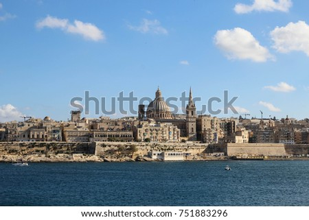 VALLETTA, MALTA - OCTOBER 6,2017 Stunning view on Valletta old town with cathedral from Sliema waterfront on the opposite shore on a sunny day