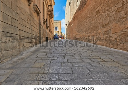 Valletta, Malta - SEPTEMBER 11, 2013: Typical street in the old town Malta. Malta is a southern European country in the Mediterranean Sea 80 km (50 mi) south of Sicily. - stock photo