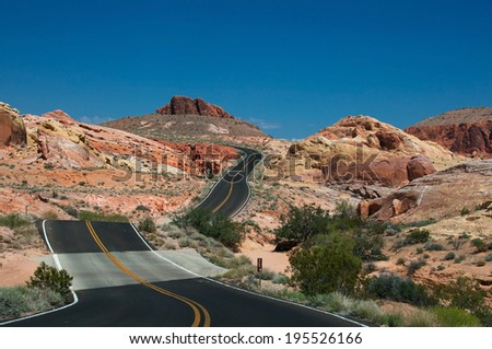 Valley of Fire Road, main road, going through the varicolored rocks of Valley of Fire State Park, located near Las Vegas, USA - stock photo