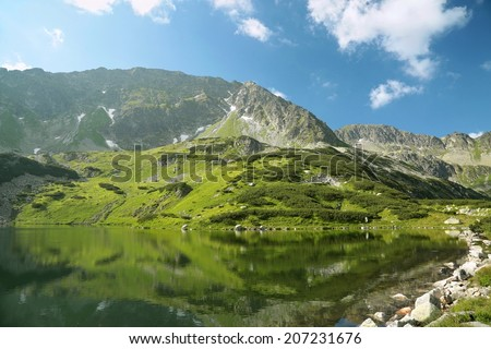Valley of five ponds at an altitude of 1625 meters in the Tatra Mountains, Poland. - stock photo