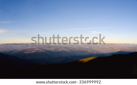 Valley of the mountains at sunset.  panorama - stock photo