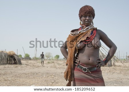 VALLEY OMO, ETHIOPIA - MARCH 16: Portrait of unidentified Hamer woman on March 16, 2012, Colcho, Omo Valley, Ethiopia. There are many miscegenations in Colcho village mostly inhabited by Karo people. - stock photo