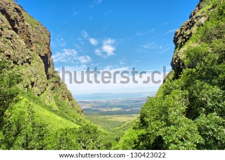 Valley on sunny day. Shot near Landdroskop, Hottentots-Holland Mountains nature reserve, near Somerset West, Western Cape, South Africa. - stock photo