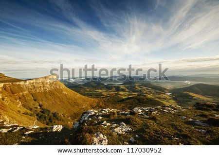 Valley view at sunrise from the top of the mountains, Sierra Salvada, Spain - stock photo