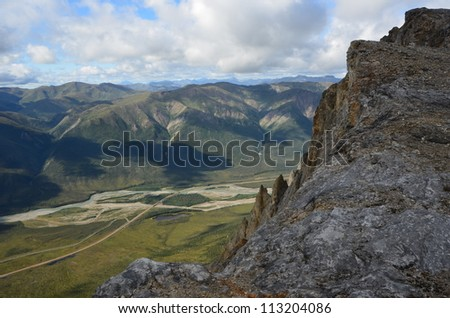 Valley View from a Cliff Face - stock photo