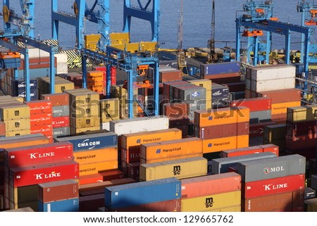 VALPARAISO, CHILE- FEB 10: The busy cargo seaport in South America on February 10, 2010 in Valparaiso, Chile. It is the most important seaport in Chile. - stock photo