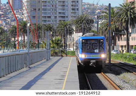 "VALPARAISO, CHILE-MAY 29: Train of ""Metro Valparaiso"" approach to the station on May 29, 2013 in Valparaiso, Chile.  - stock photo"