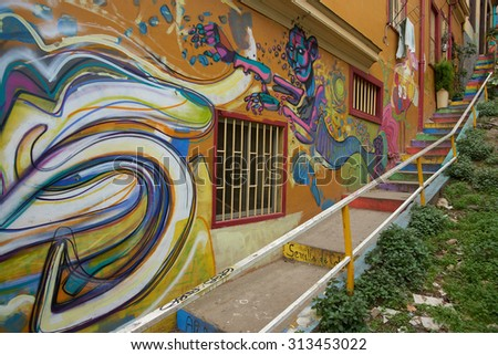 VALPARAISO, CHILE - SEPTEMBER 04, 2015: Colourful street art decorating houses in the UNESCO World Heritage port city of Valparaiso in Chile. - stock photo