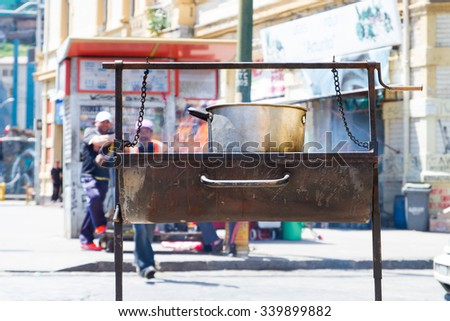 VALPARAISO - NOVEMBER 07: People and street art interaction in the districts of the protected UNESCO World Heritage Site of Valparaiso on November 7, 2015 in Valparaiso, Chile - stock photo