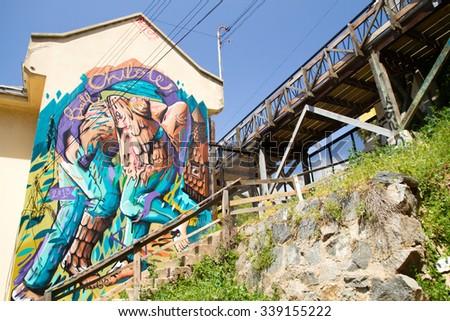 VALPARAISO - NOVEMBER 07: Street art at Reina Victoria funicular, Alegre districts of the protected UNESCO World Heritage Site of Valparaiso on November 7, 2015 in Valparaiso, Chile - stock photo