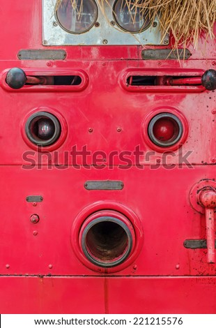 Valve control of fire truck look like human face - stock photo