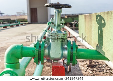Valve mounted on rooftop industry building . - stock photo