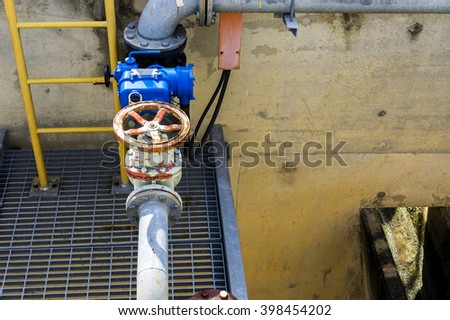 Valve of industrial piping system - stock photo