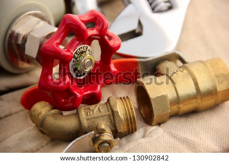 Valves and wrench. - stock photo