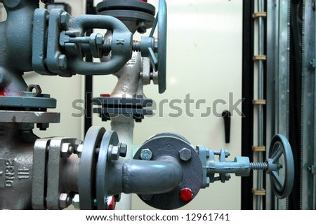 Valves on a pipeline. Blue colored - stock photo