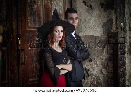 Vampire and the Witch are standing in front of the door of the haunted house