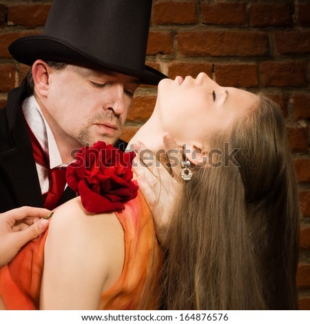 Vampire attacking girl - stock photo
