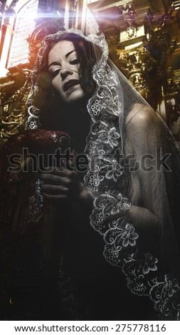 Vampire, concept virgin, religion, woman with white headdress and gold crown - stock photo