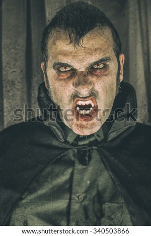 Vampire Dracula. Horror male vampire portrait, edited with vintage film effects. - stock photo