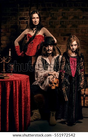 Vampire family indoors on background