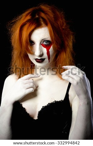 Vampire Halloween Woman portrait. Beauty Sexy Vampire Girl with dripping blood on her mouth. Vampire makeup Fashion Art design