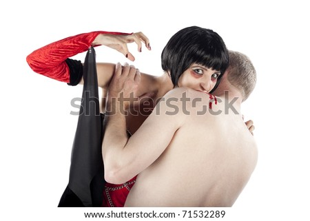 Vampire woman attacking a man and looking at the camera. Isolated on pure white background. - stock photo