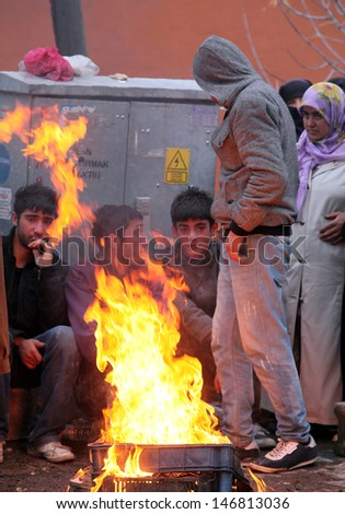 VAN, TURKEY - OCTOBER 25: Earthquake victims sitting around a campfire on October 25, 2011 in Van, Turkey. It is 604 killed and 4152 injured in Van-Ercis Earthquake.