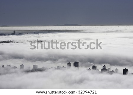 Vancouver as seen being under a heavy blanket of fog