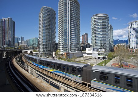 VANCOUVER, BC - APRIL 12, 2014: SkyTrain, light and fully automatic transit metro system has 69 km of track and 47 stations on 3 lines. Expo Line was open 1985, Millennium in 2002 and Canada Line 2009 - stock photo