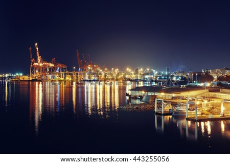 VANCOUVER, BC - AUG 17: Sea port with crane and cargo containers at night on August 17, 2015 in Vancouver, Canada. With 603k population, it is one of the most ethnically diverse cities in Canada.