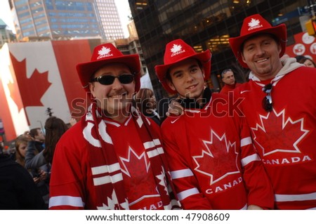 VANCOUVER, BC, CANADA - FEBRUARY 28: Canadian men ready to celebrate possible Canada Hockey Team Gold Medal win at 2010 Winter Games, February 28, 2010 in Vancouver, BC, Canada - stock photo