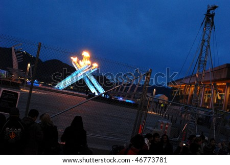 VANCOUVER, BC, CANADA - FEBRUARY 13: Security fence surrounds Vancouver 2010 Winter Olympic Games cauldron and keeps public at a distance, February 13, 2010, Vancouver, BC, Canada.