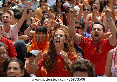 VANCOUVER, BC, CANADA - JULY 11: Spanish fans watch Spain soccer team FIFA World Cup final game vs Dutch soccer team on Granville Street, July 11, 2010 in Vancouver, BC, Canada