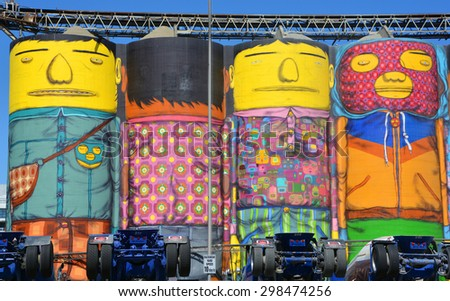 VANCOUVER BC CANADA JUNE 10 2015: Ocean Concrete is Granville Island last tie to to its industrial past, and now 6 concrete silos are being transformed by two famous Brazilian street artists Os Gemeos - stock photo