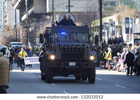 VANCOUVER, BC, CANADA - MARCH 18, 2013 - Armored car rolls resplendently in the annual Saint Patrick's Day Parade in Vancouver, Canada.