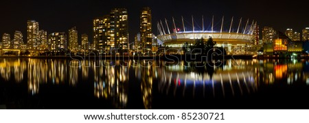 Vancouver BC Canada Skyline along False Creek at Night Panorama - stock photo