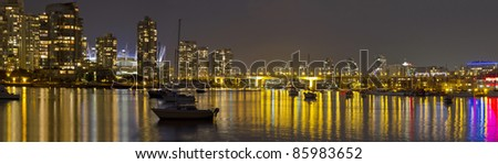 Vancouver BC Skyline and Cambie Bridge at Night Panorama - stock photo