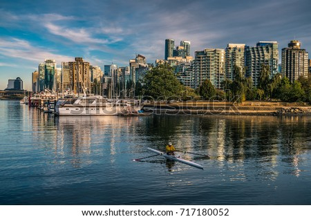 Vancouver, British Columbia, Canada,September 16 2017. Rowers in Kayaks in Coal Harbor Vancouver with Vancouver Downtown backgrounds