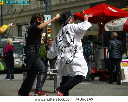 VANCOUVER, BRITISH COLUMBIA - MARCH 27: Japanese demonstration and fundraising to help victims after the earthquake in downtown Vancouver on March 27, 2011 2 p.m. - stock photo
