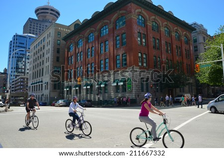 VANCOUVER, CA - JULY 28: Bikers at Downtown Vancouver Lookout arean July 28, 2014  in Vancouver, Canada. Famous Observation Deck, situated in the heart of Vancouver, and it has a revolving restaurant. - stock photo