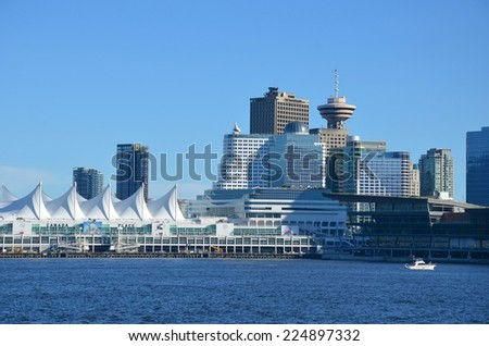 VANCOUVER, CA - JULY 27: Canada Place Harbor on July 27, 2014 in Vancouver, Canada. Famous Vancouver main cruise ship terminal, it was built in 1927. - stock photo