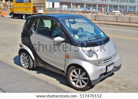 VANCOUVER,CA - JULY 05:  Silver Smart Car at Vancouver Street on July 5, 2008 in Vancouver, Canada. A small stylish city car with company headquarters in Germany, and factory in France. - stock photo
